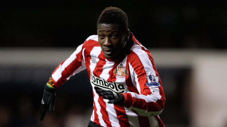 Asamoah Gyan arrives in England amid Sunderland and Fulham interest