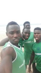 Dreams FC players engage in beach workout following league break