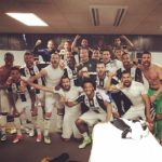 Kwadwo Asamoah celebrates Barcelona victory in a charged mood with teammates