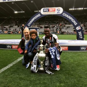 Atsu poses with family as he celebrates Championship victory with Newcastle