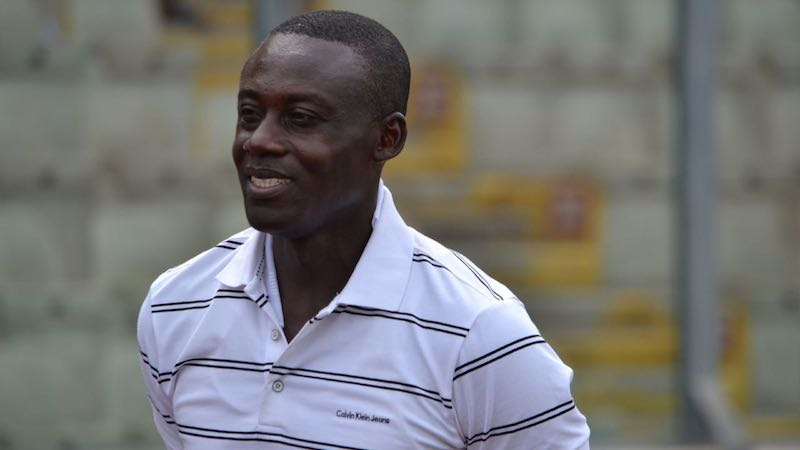 Liberty Coach Michael Osei congratulates players after great escape
