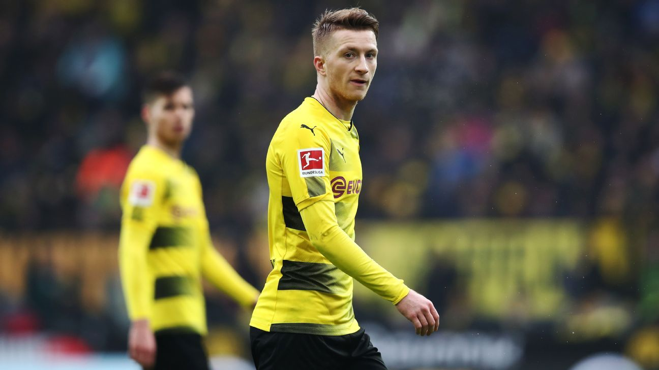 Marcos Reus returns to help Borussia Dortmund beat Hamburg