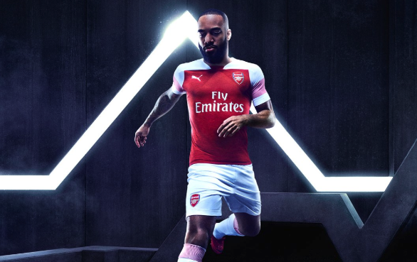 Arsenal's new kit features red pin stripes on white sleeves and divides fans