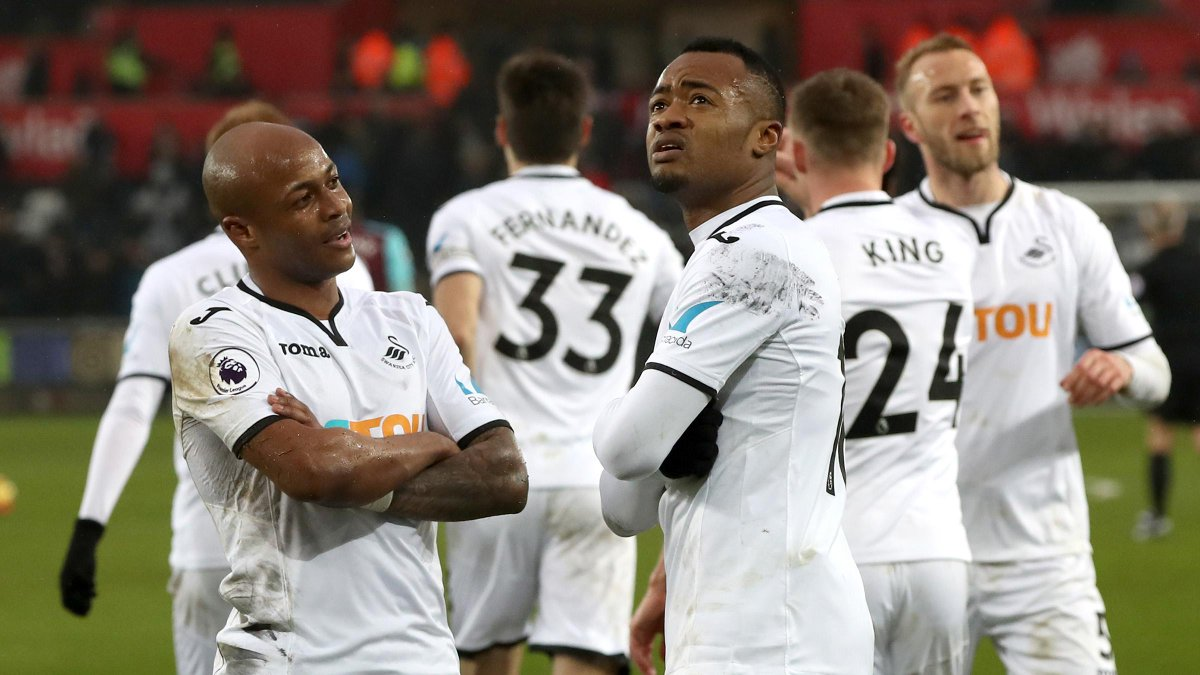 Market value for Ayew brothers fall after Swansea City relegation