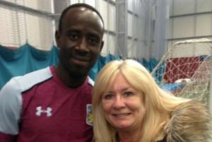Albert Adomah leads Aston Villa teammates to teach kids football lessons