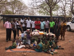 Elmina Sharks present items to Tamale Children's Home