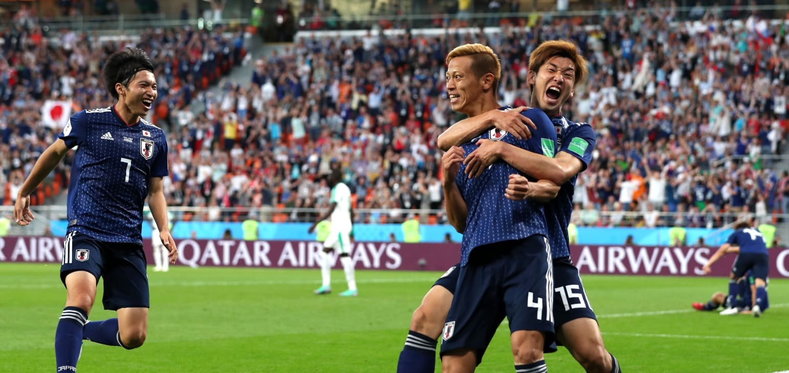 Analysis: Spirited Japan edge closer to knockout rounds