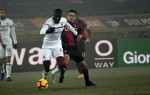 Ten-man AC Milan frustrated in Bologna