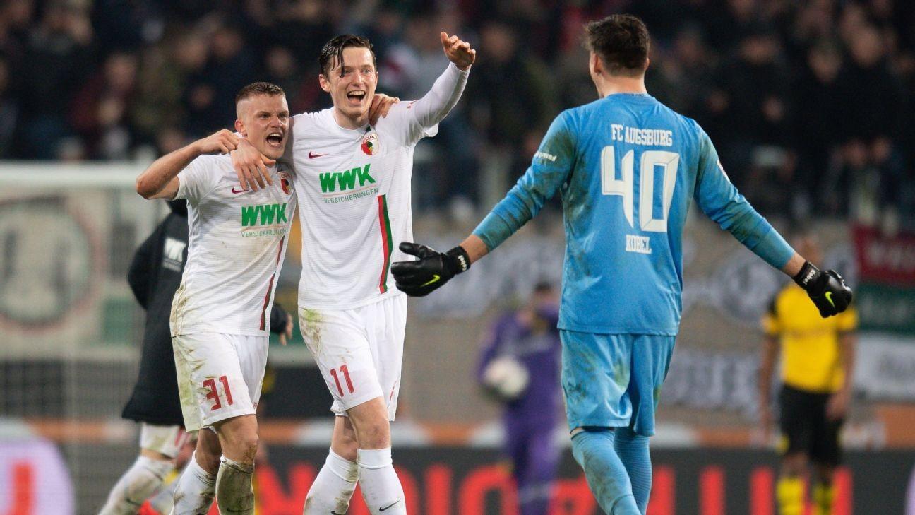 Dortmund shock loss at Augsburg gives Bayern chance to level at top