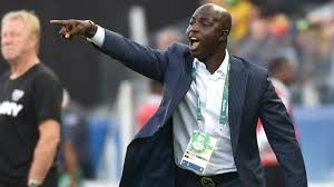 Samson Siasia slapped with a life ban and fined $50,000