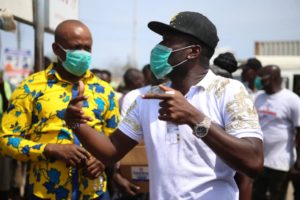 VIDEO: Asamoah Gyan shares sanitizers to residents of Weija-Gbawe constituency for protection against Coronavirus