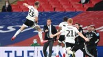 Bryan's brilliance seals Fulham's Premier League return