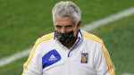 Manager banned for smoking on bench in match