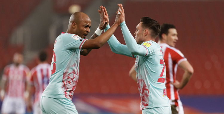 Andre Ayew scores late penalty as Swansea City beat Stoke City 2-1 away